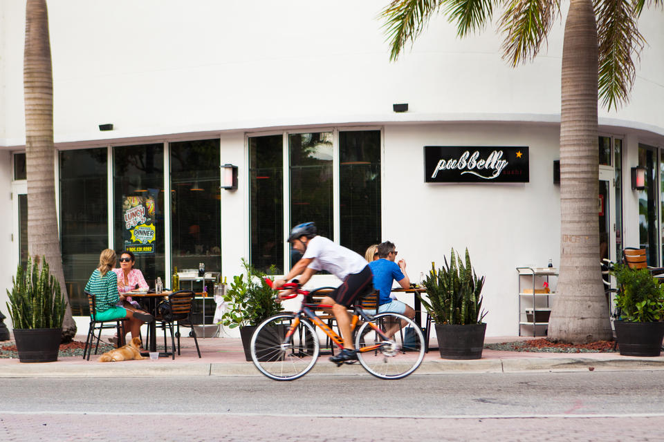 Man Riding Bike Outside Pubbelly