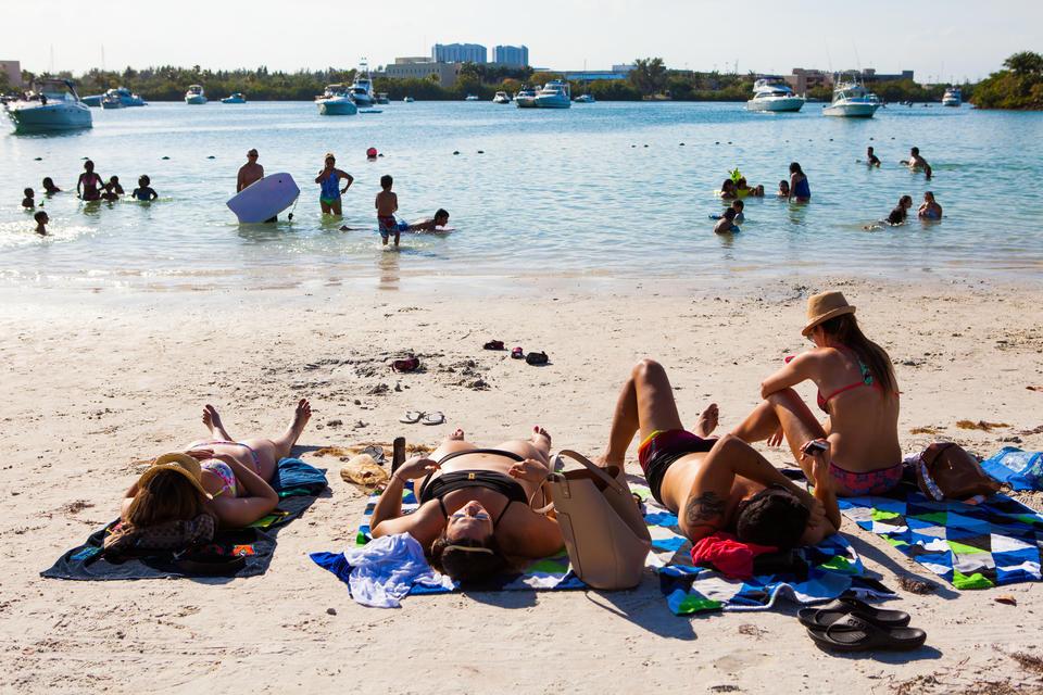 Women Tanning On Beach
